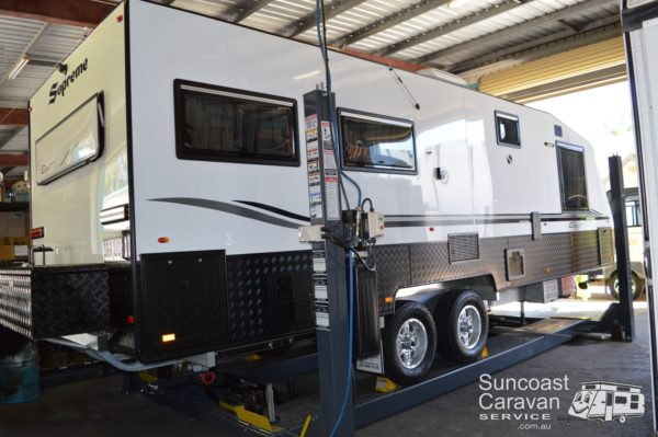 caravan on hoist for safety & gas certification