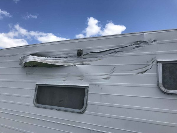 impact damage to side of caravan for insurance repairs